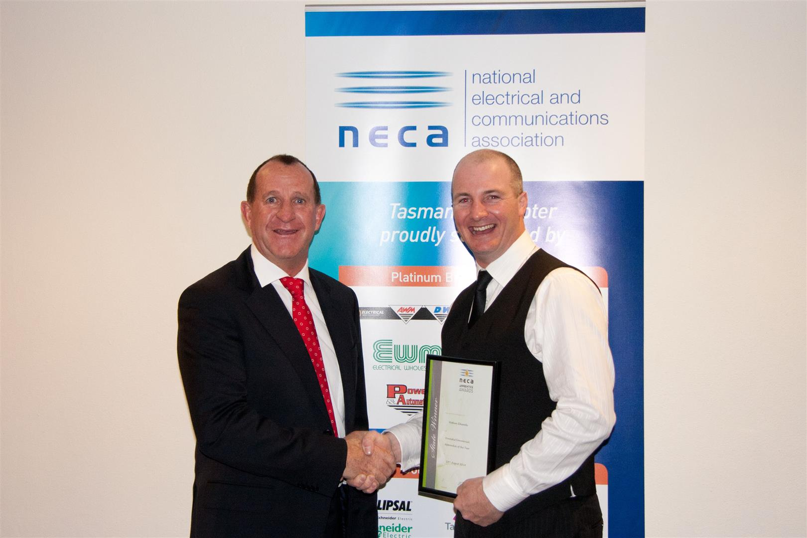 Company Director, Bill Fromberg, accepting apprentice of the year award on behalf of Nathan Edwards